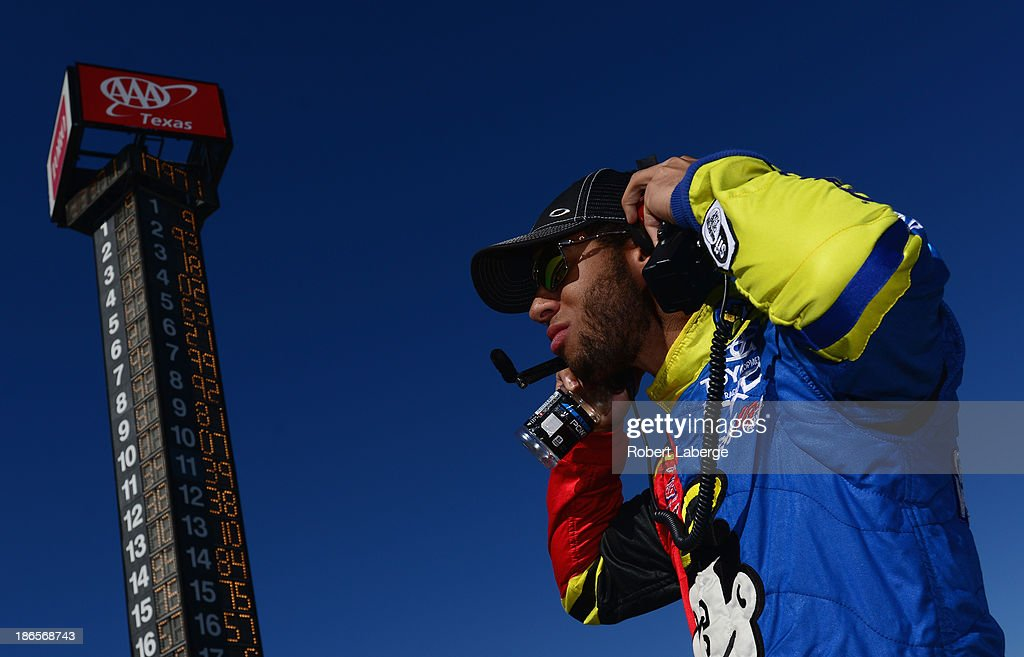 Darrell Wallace Jr., driver of the #54 Camping World / Good Sam Toyota, stands on the grid during qualifying for the NASCAR Camping World Truck Series WinStar World Casino 350k at Texas Motor Speedway on November 1, 2013 in Fort Worth, Texas.