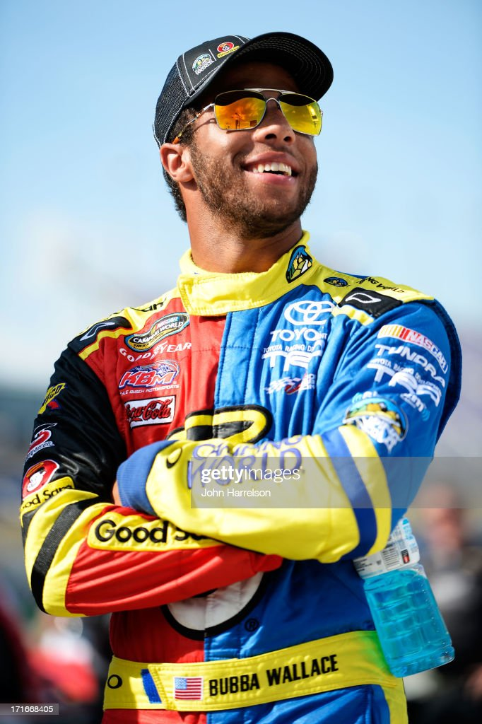 Darrell Wallace Jr., driver of the #54 Camping World/Good Sam Toyota, looks on during qualifying for the NASCAR Camping World Truck Series UNOH 225 at Kentucky Speedway on June 27, 2013 in Sparta, Kentucky.