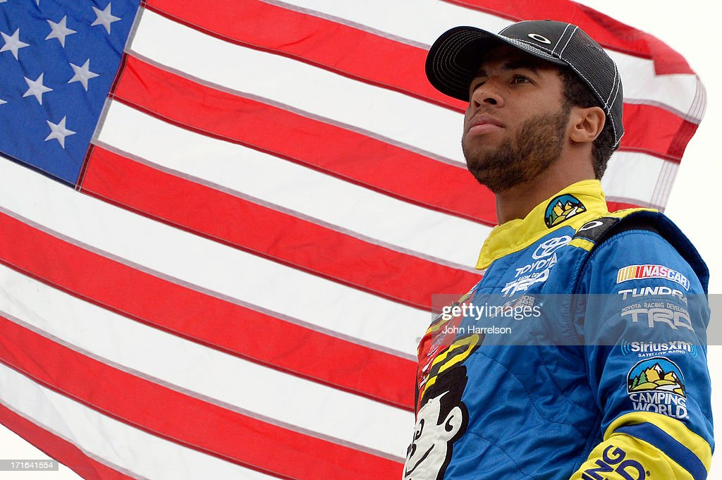Darrell Wallace Jr., driver of the #54 Camping World/Good Sam Toyota, stands in the garage area during practice for the NASCAR Camping World Truck Series UNOH 225 at Kentucky Speedway on June 27, 2013 in Sparta, Kentucky.