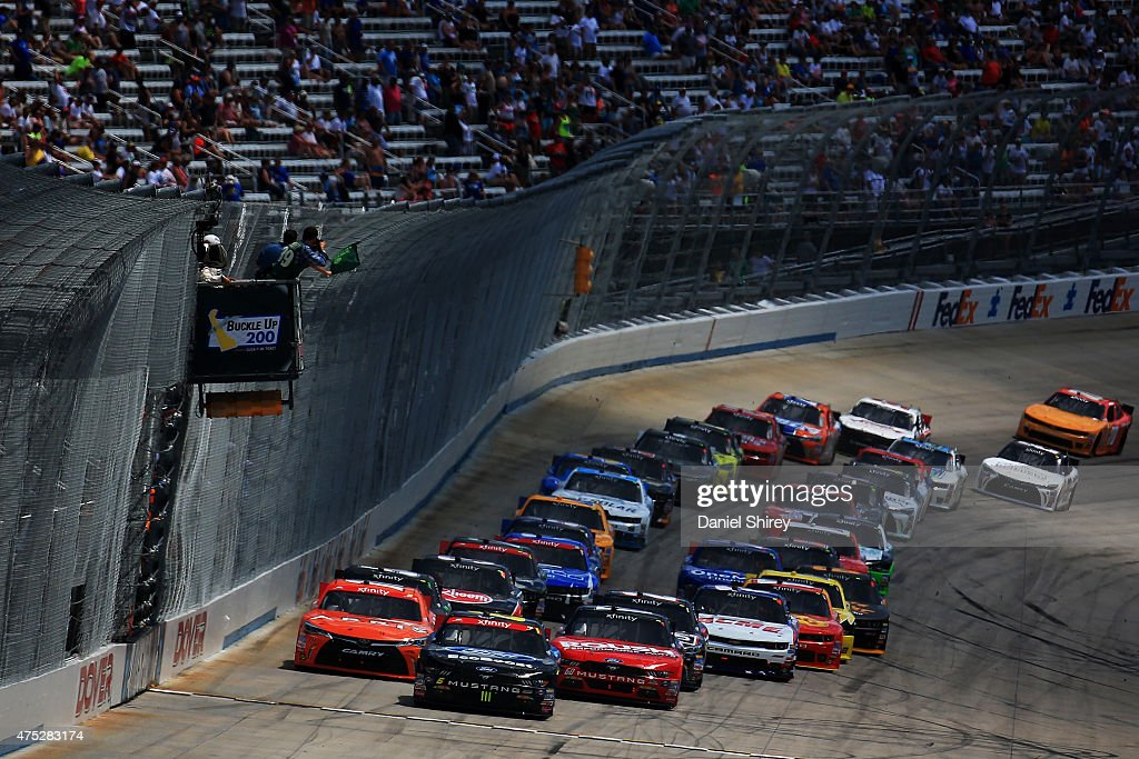 <a gi-track='captionPersonalityLinkClicked' href=/galleries/search?phrase=Darrell+Wallace+Jr.&family=editorial&specificpeople=7123625 ng-click='$event.stopPropagation()'>Darrell Wallace Jr.</a>, driver of the #6 Ford EcoBoost Ford, and <a gi-track='captionPersonalityLinkClicked' href=/galleries/search?phrase=Chris+Buescher&family=editorial&specificpeople=7728537 ng-click='$event.stopPropagation()'>Chris Buescher</a>, driver of the #60 Roush Performance Products Ford, lead the field to the green flag for the running of the NASCAR XFINITY Series Buckle Up 200 presented by Click It or Ticket at Dover International Speedway on May 30, 2015 in Dover, Delaware.