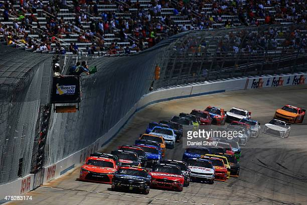 Darrell Wallace Jr driver of the Ford EcoBoost Ford and Chris Buescher driver of the Roush Performance Products Ford lead the field to the green flag...
