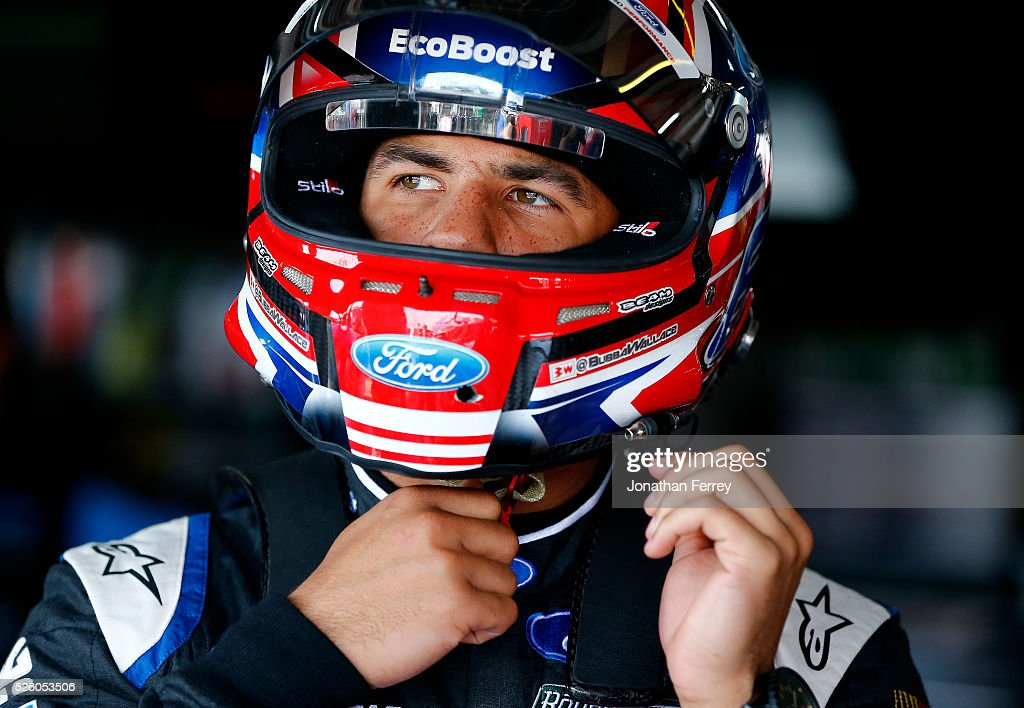 Darrell Wallace Jr, driver of the #6 Kleen Perfomance Ford, stands in the garage area during practice for the NASCAR XFINITY Series Sparks Energy 300 at Talladega Superspeedway on April 29, 2016 in Talladega, Alabama.