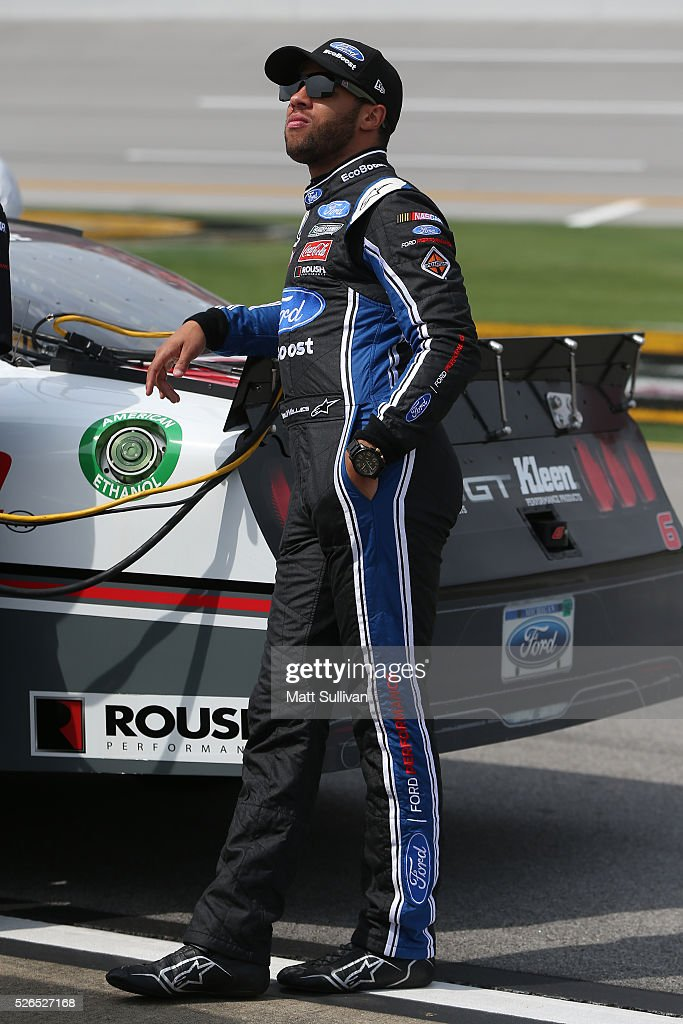 Darrell Wallace Jr, driver of the #6 Kleen Perfomance Ford, stands on the grid during qualifying for the NASCAR XFINITY Series Sparks Energy 300 at Talladega Superspeedway on April 30, 2016 in Talladega, Alabama.