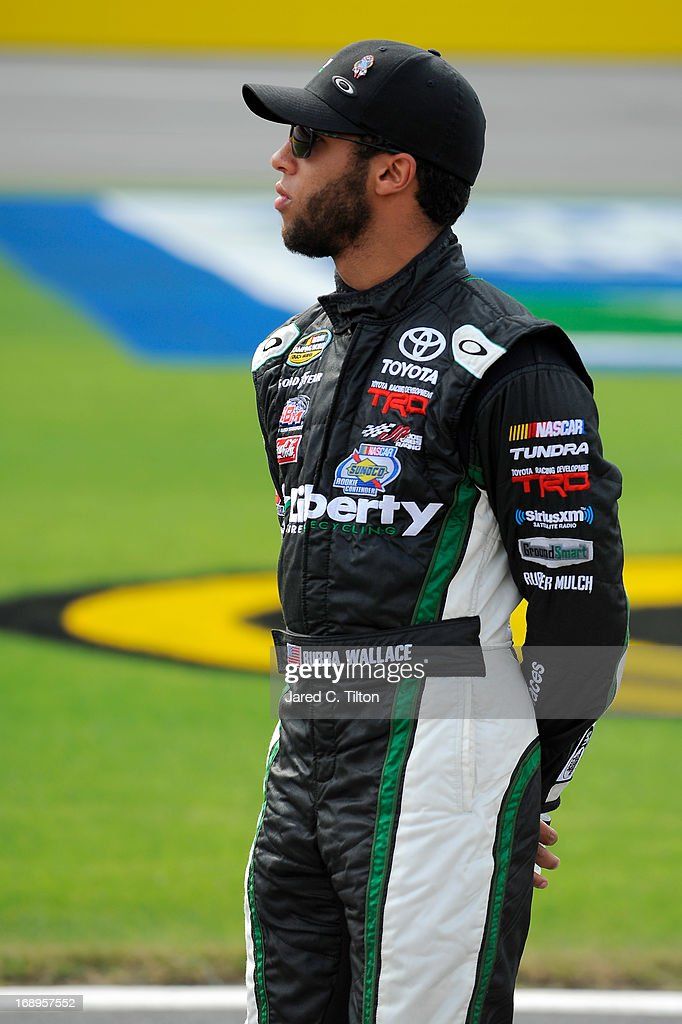 Darrell Wallace Jr., driver of the #54 Liberty Tire Recycling Toyota, waits to qualify for the NASCAR Camping World Truck Series North Carolina Education Lottery 200 at Charlotte Motor Speedway on May 17, 2013 in Concord, North Carolina.