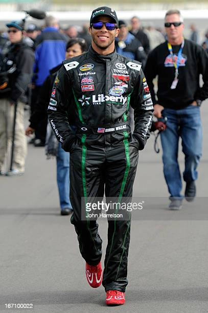 Darrell Wallace Jr driver of the LibertyTireRecycling/Ground SmartRubber Toyota walks on the grid during qualifying for the NASCAR Camping World...