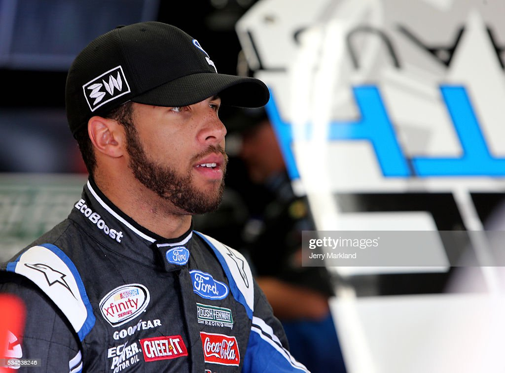 <a gi-track='captionPersonalityLinkClicked' href=/galleries/search?phrase=Darrell+Wallace+Jr.&family=editorial&specificpeople=7123625 ng-click='$event.stopPropagation()'>Darrell Wallace Jr.</a>, driver of the #6 LoudMouth Exhaust Ford, stands in the garage area during practice for the NASCAR XFINITY Series Hisense 4K TV 300 at Charlotte Motor Speedway on May 27, 2016 in Charlotte, North Carolina.