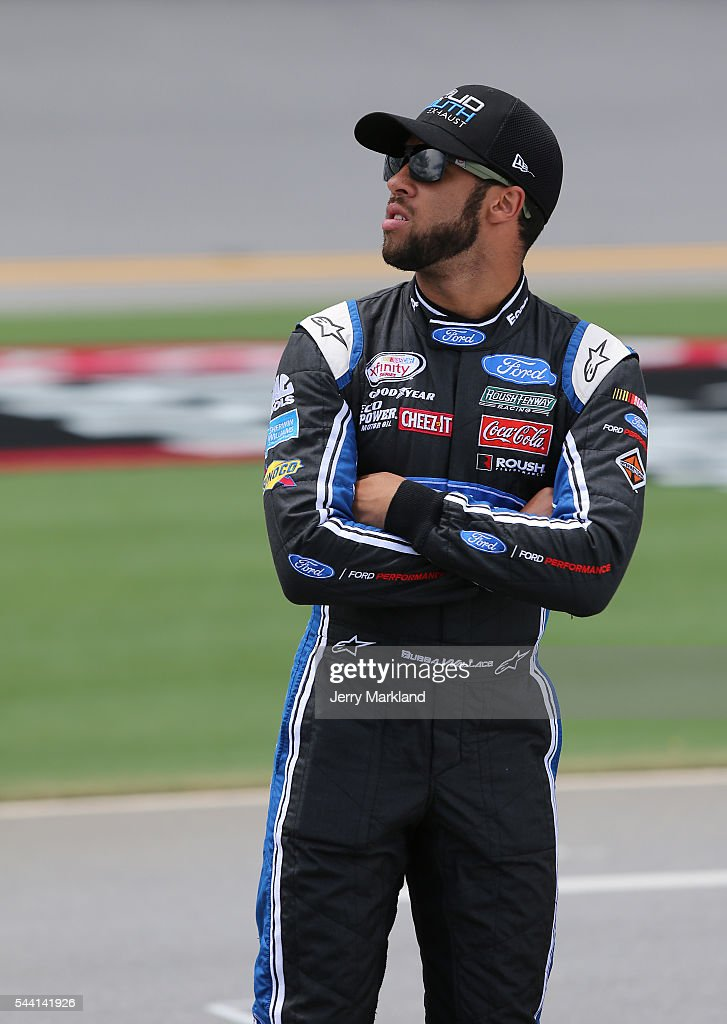 Darrell Wallace Jr., driver of the #6 LoudMouth Exhaust Ford, stands on the grid during qualifying for the NASCAR XFINITY Series Subway Firecracker 250 at Daytona International Speedway on July 1, 2016 in Daytona Beach, Florida.