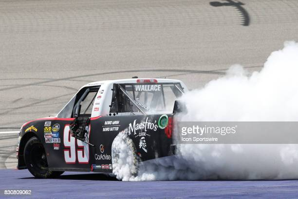 Darrell Wallace Jr driver of the Maestro's Classic Chevrolet does a burnout at the finish line after winning the Camping World Truck Series LTi...