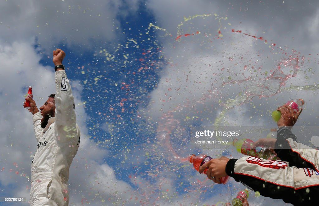 Darrell Wallace Jr., driver of the #99 Maestro's Classic Chevrolet, celebrates in victory lane after winning the NASCAR Camping World Truck Series LTi Printing 200 at Michigan International Speedway on August 12, 2017 in Brooklyn, Michigan.