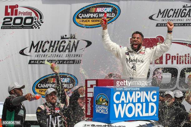 Darrell Wallace Jr driver of the Maestro's Classic Chevrolet celebrates in Gatorade Victory Lane after winning the Camping World Truck Series LTi...