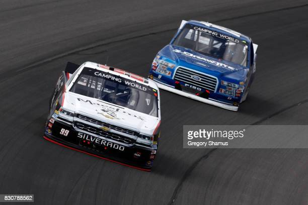 Darrell Wallace Jr driver of the Maestro's Classic Chevrolet leads Austin Cindric driver of the DrawTite/Reese Brands Ford during the NASCAR Camping...