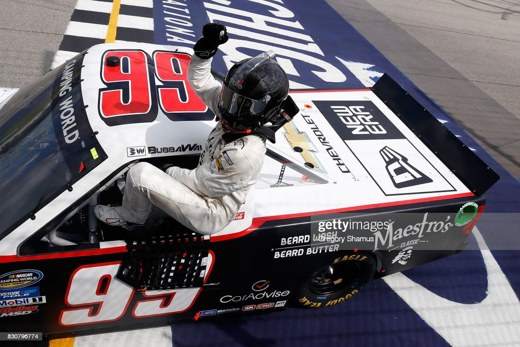 Darrell Wallace Jr., driver of the #99 Maestro's Classic Chevrolet, celebrates winning the NASCAR Camping World Truck Series LTi Printing 200 at Michigan International Speedway on August 12, 2017 in Brooklyn, Michigan.
