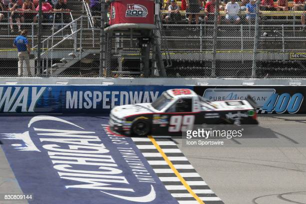 Darrell Wallace Jr driver of the Maestro's Classic Chevrolet wins the Camping World Truck Series LTi Printing 200 race on August 12 2017 at Michigan...