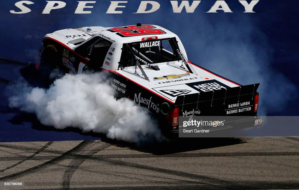 Darrell Wallace Jr., driver of the #99 Maestro's Classic Chevrolet, celebrates with a burnout after winning the NASCAR Camping World Truck Series LTi Printing 200 at Michigan International Speedway on August 12, 2017 in Brooklyn, Michigan.