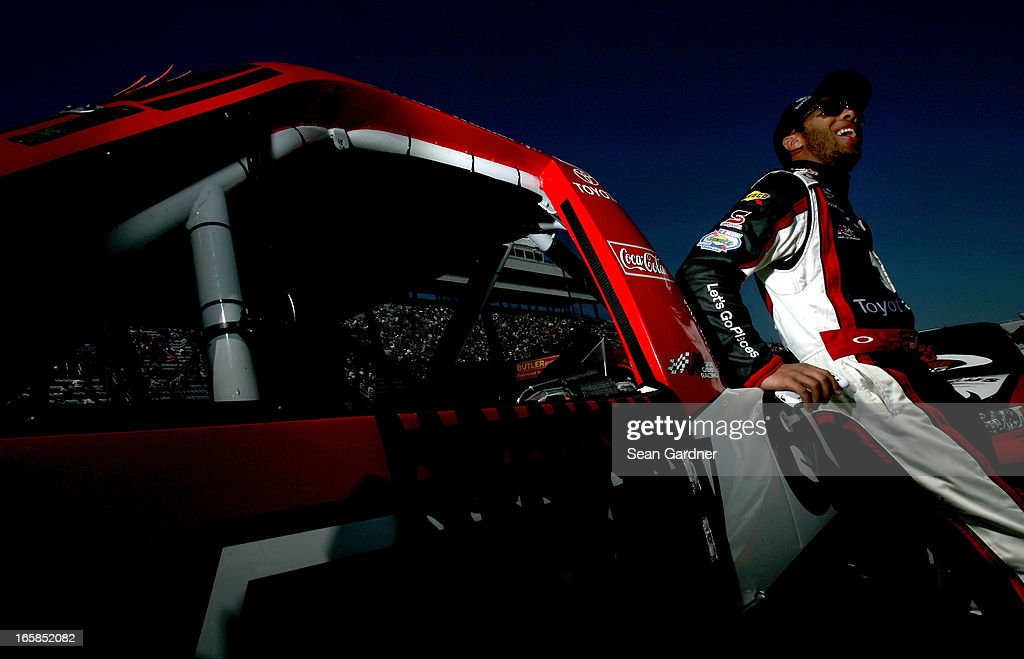 Darrell Wallace Jr., driver of the #54 Toyota Care Toyota, stands on the grid during pre-race ceremonies for the NASCAR Camping World Truck Series Kroger 250 on April 6, 2013 at Martinsville Speedway in Ridgeway, Virginia.