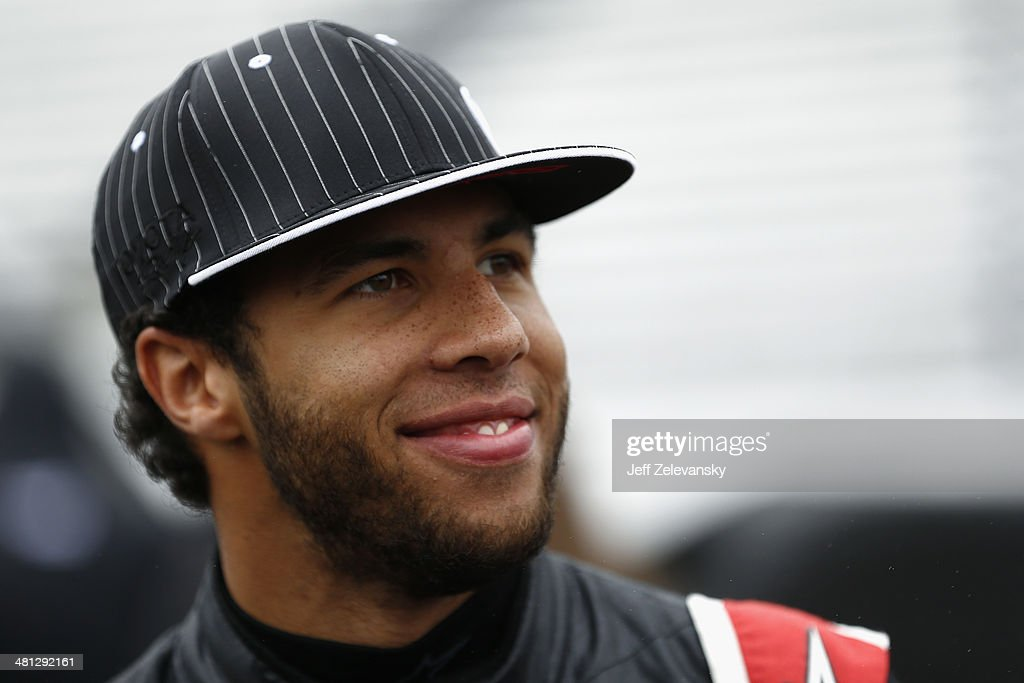 <a gi-track='captionPersonalityLinkClicked' href=/galleries/search?phrase=Darrell+Wallace+Jr.&family=editorial&specificpeople=7123625 ng-click='$event.stopPropagation()'>Darrell Wallace Jr.</a>, driver of the #54 Toyota No. 1 For Everyone Sales Event Toyota, looks on in the garage area during rain-cancelled qualifying for the NASCAR Camping World Truck Series Kroger 250 at Martinsville Speedway on March 29, 2014 in Martinsville, Virginia.