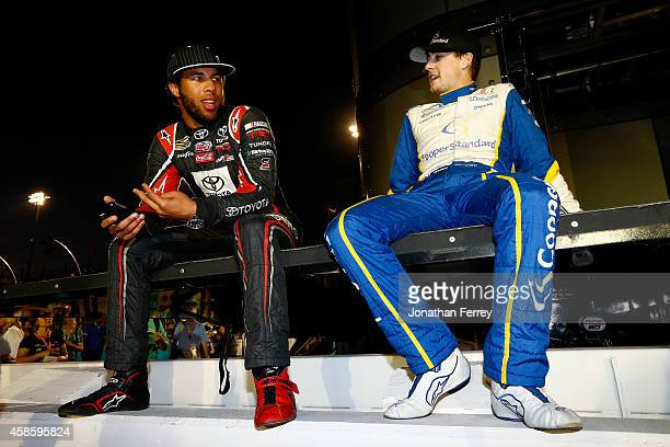 Darrell Wallace Jr driver of the ToyotaCare Toyota and Ryan Blaney driver of the Cooper Standard Ford sit behind stage during driver introductions...
