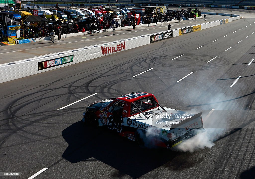Darrell Wallace Jr., driver of the #54 ToyotaCare Toyota, celebrates after winning the NASCAR Camping World Truck Series Kroger 200 at Martinsville Speedway on October 26, 2013 in Martinsville, Virginia.