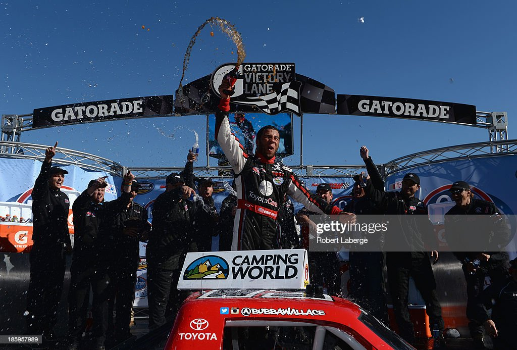 Darrell Wallace Jr., driver of the #54 ToyotaCare Toyota, celebrates in victory lane after winning the NASCAR Camping World Truck Series Kroger 200 at Martinsville Speedway on October 26, 2013 in Martinsville, Virginia.