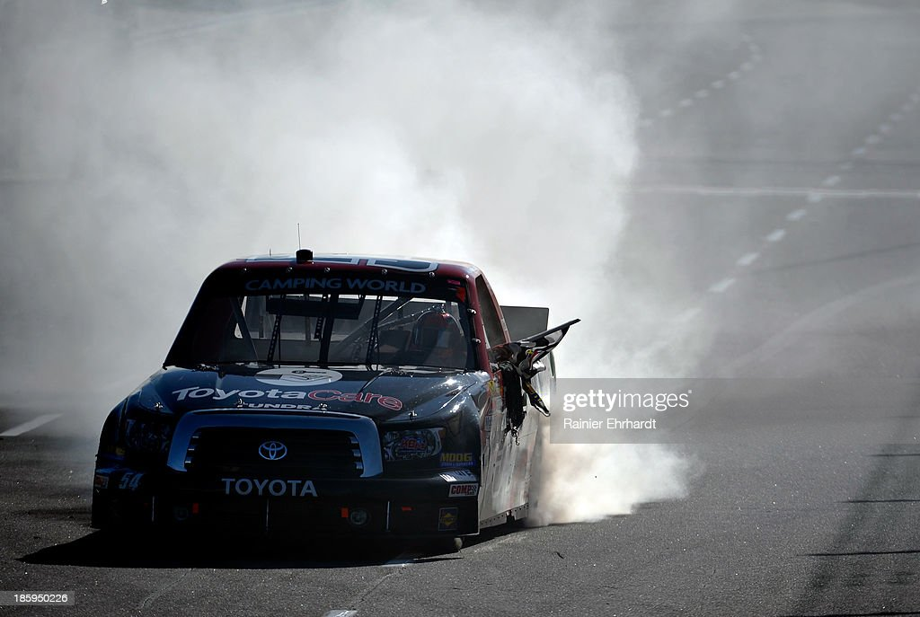 Darrell Wallace Jr., driver of the #54 ToyotaCare Toyota, celebrates with a burnout after winning the NASCAR Camping World Truck Series Kroger 200 at Martinsville Speedway on October 26, 2013 in Martinsville, Virginia.