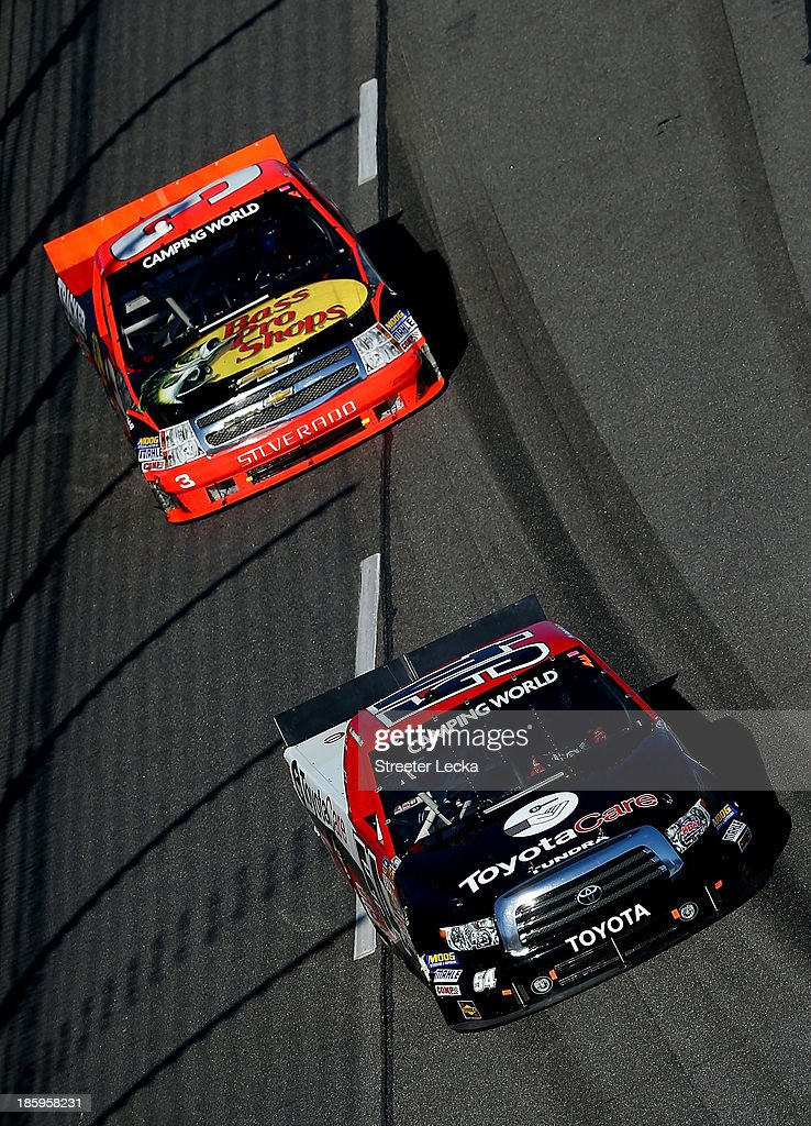 Darrell Wallace Jr., driver of the #54 ToyotaCare Toyota, leads <a gi-track='captionPersonalityLinkClicked' href=/galleries/search?phrase=Ty+Dillon&family=editorial&specificpeople=6312493 ng-click='$event.stopPropagation()'>Ty Dillon</a>, driver of the #3 Bass Pro Shops/Tracker Boats Chevrolet, during the NASCAR Camping World Truck Series Kroger 200 at Martinsville Speedway on October 26, 2013 in Martinsville, Virginia.