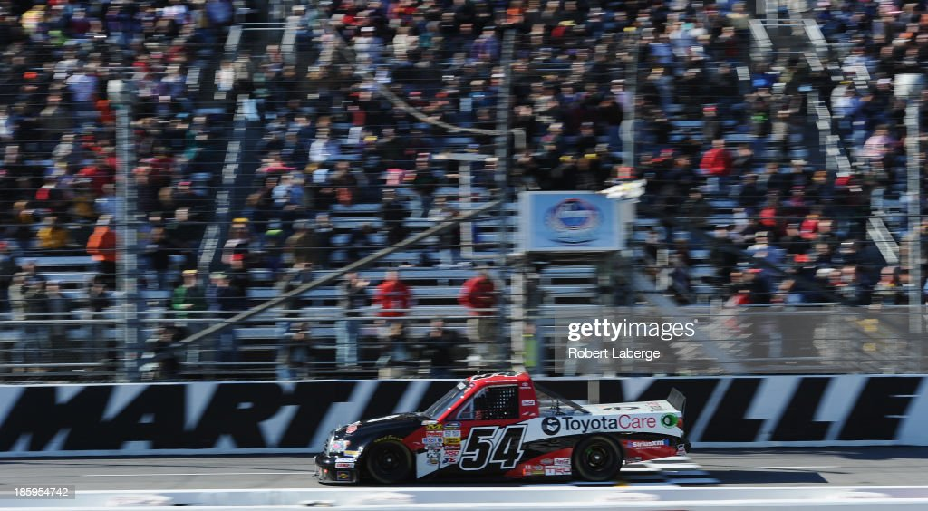 Darrell Wallace Jr., driver of the #54 ToyotaCare Toyota Toyota, crosses the finish line to win the NASCAR Camping World Truck Series Kroger 200 at Martinsville Speedway on October 26, 2013 in Martinsville, Virginia.