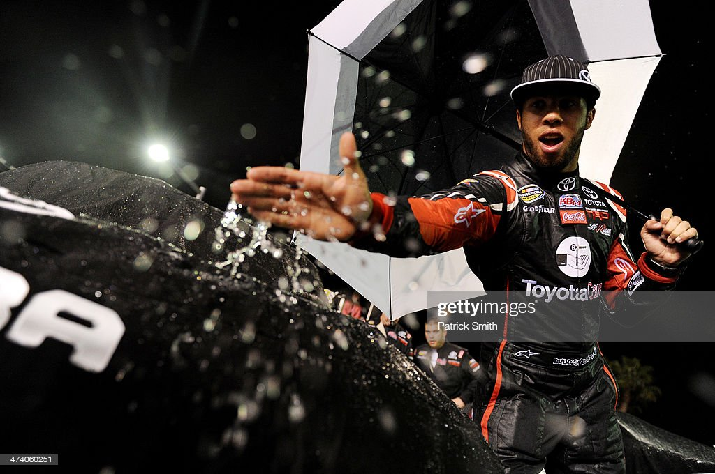 <a gi-track='captionPersonalityLinkClicked' href=/galleries/search?phrase=Darrell+Wallace+Jr.&family=editorial&specificpeople=7123625 ng-click='$event.stopPropagation()'>Darrell Wallace Jr.</a>, driver of the #54 ToyotaCare Toyota, wipes water off of the cover of his truck during pre-race ceremonies for the Camping World Truck Series NextEra Energy Resources 250 at Daytona International Speedway on February 21, 2014 in Daytona Beach, Florida.