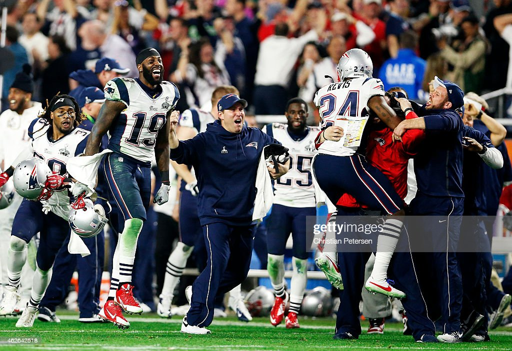 Darrelle Revis and Brandon LaFell of the New England Patriots react after an interception against the Seattle Seahawks in the fourth quarter during...