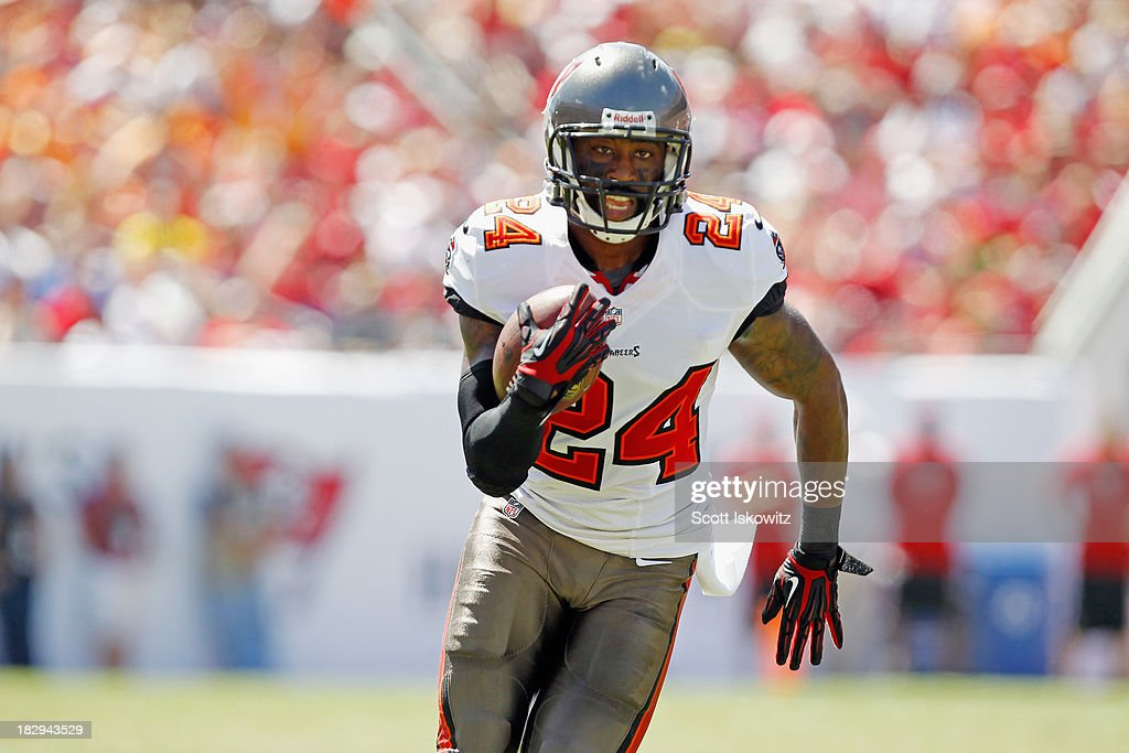 <a gi-track='captionPersonalityLinkClicked' href=/galleries/search?phrase=Darrelle+Revis&family=editorial&specificpeople=2198124 ng-click='$event.stopPropagation()'>Darrelle Revis</a> #24 of the Tampa Bay Buccaneers runs with the ball against the Arizona Cardinals at Raymond James Stadium on September 29, 2013 in Tampa, Florida.