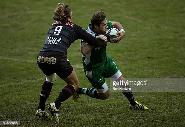Darren Allinson of London Irish is tackled by Charl McLeod of Grenoble during the European Rugby Challenge Cup match between London Irish and...