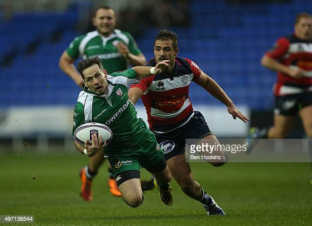 Darren Allinson of London Irish is tackled by Paul Abadie of Agen during the European Rugby Challenge Cup match between London Irish and Agen at...