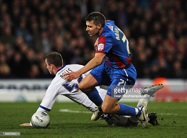 Darren Ambrose of Crystal Palace battles with Joe Ralls of Cardiff City during the Carling Cup Semi Final First Leg match between Crystal Palace and...