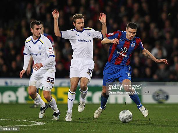 Darren Ambrose of Crystal Palace evades Stephen McPhail and Joe Ralls of Cardiff City during the Carling Cup Semi Final First Leg match between...
