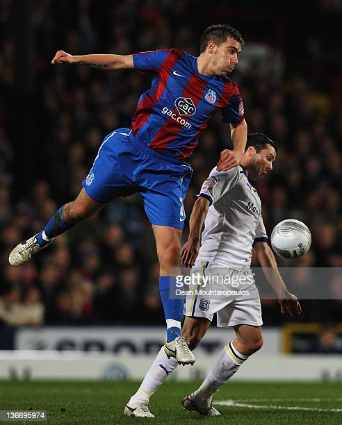 Darren Ambrose of Crystal Palace outjumps Don Cowie of Cardiff City during the Carling Cup Semi Final First Leg match between Crystal Palace and...