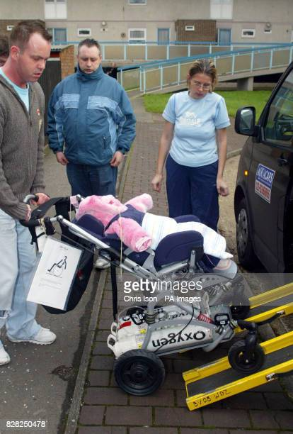 Darren and Debbie Wyatt look on as their severely disabled daughter Charlotte is put into a special taxi at their Portsmouth home Tuesday December 6...