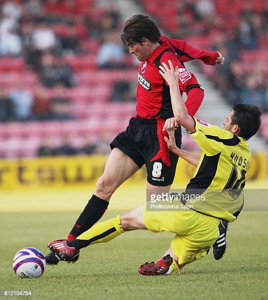 Darren Anderton of Bournemouth is tackled by Mark Hudson of Rotherham during the AFC Bournemouth v Rotherham United CocaCola Football League Two...