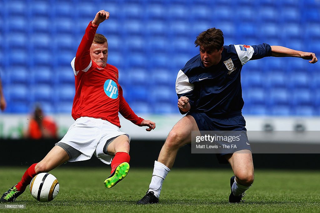 <a gi-track='captionPersonalityLinkClicked' href=/galleries/search?phrase=Darren+Anderton&family=editorial&specificpeople=223907 ng-click='$event.stopPropagation()'>Darren Anderton</a> of the FA Legends in action during the Army FA and FA Legends Match at Madejski Stadium on May 18, 2013 in Reading, England.