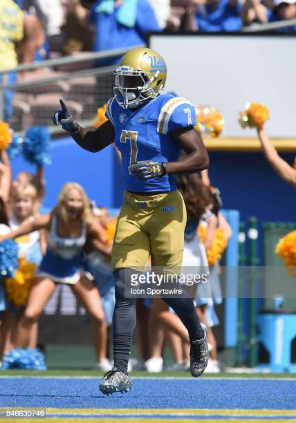 Darren Andrews celebrates after scoring a touchdown during a college football game between the Hawai'i Rainbow Warriors and the UCLA Bruins on...