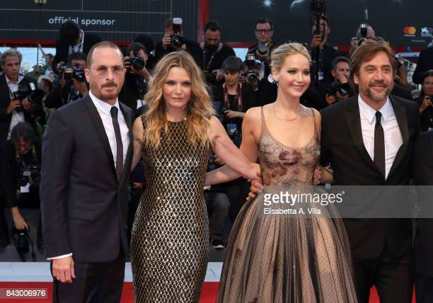 Darren Aronofsky Michelle Pfeiffer Jennifer Lawrence and Javier Bardem walk the red carpet ahead of the 'mother' screening during the 74th Venice...