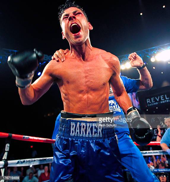 Darren Barker right of England celebrates his split decision victory over Daniel Geale from Australia during their IBF Middleweight Championship...