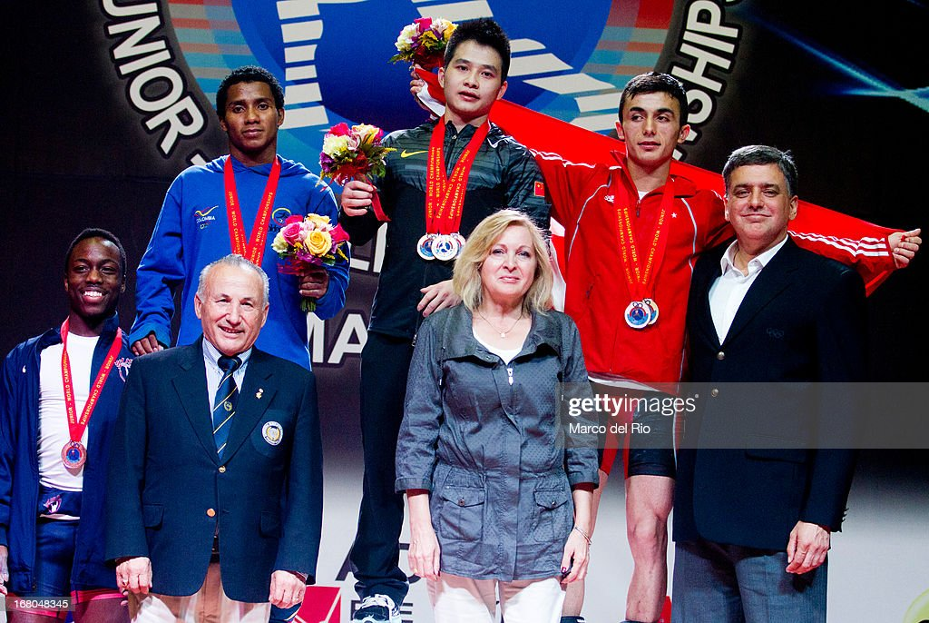 Darren Barnes of US (L), Colombian Mendoza (2L-R), Xiameng Wei of China (3L-R) and Muammer Sahin (R) with tournament officials during podium of the Men's 56kg during day one of the 2013 Junior Weightlifting World Championship at Maria Angola Convention Center on April 04, 2013 in Lima, Peru.