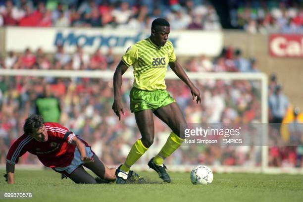 Darren Beckford Norwich City gets past Manchester United's Bryan Robson