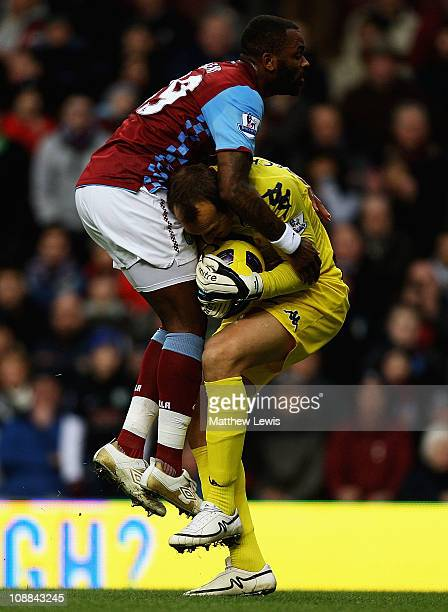 Darren Bent of Aston Villa and Mark Schwarzer of Fulham collide during the Barclays Premier League match between Aston Villa and Fulham at Villa Park...
