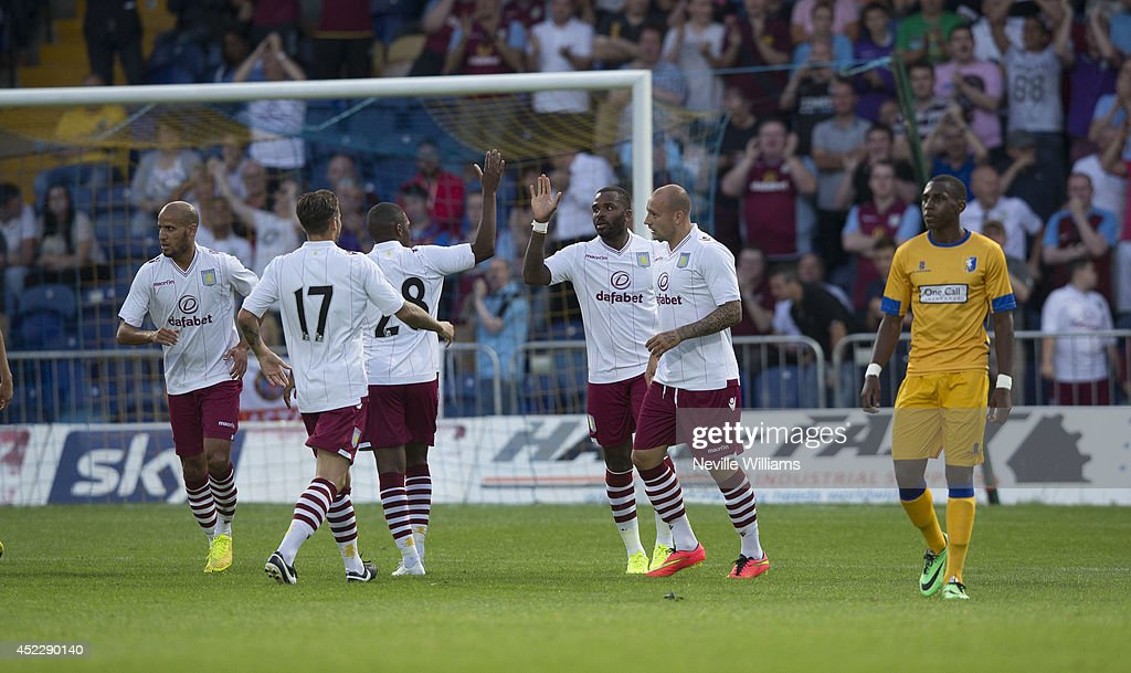 <a gi-track='captionPersonalityLinkClicked' href=/galleries/search?phrase=Darren+Bent&family=editorial&specificpeople=215162 ng-click='$event.stopPropagation()'>Darren Bent</a> of Aston Villa celebrates after scoring his first goal during the pre season friendly match between Mansfield Town and Aston Villa at the One Call Stadium on July 17, 2014 in Mansfield, England.