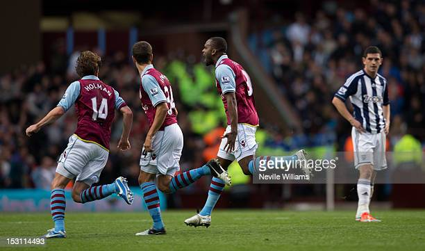 Darren Bent of Aston Villa celebrates after scoring the equalizing goal during the Barclays Premier League match between Aston Villa and West...