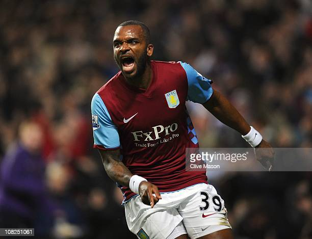 Darren Bent of Aston Villa celebrates after scoring the opening goal on his debut during the Barclays Premier League match between Aston Villa and...
