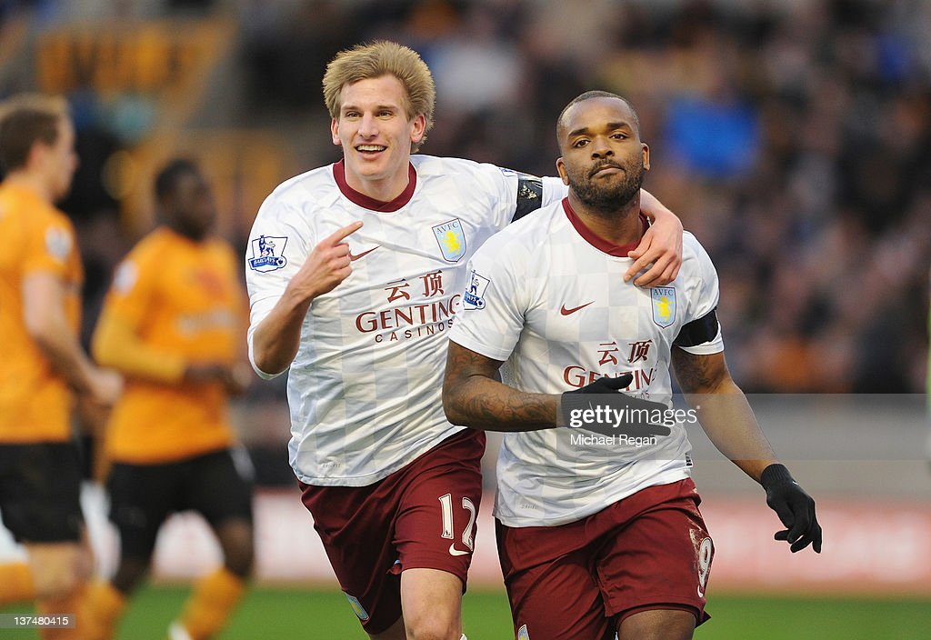 <a gi-track='captionPersonalityLinkClicked' href=/galleries/search?phrase=Darren+Bent&family=editorial&specificpeople=215162 ng-click='$event.stopPropagation()'>Darren Bent</a> of Aston Villa celebrates scoring a penalty to make it 1-0 with team mate <a gi-track='captionPersonalityLinkClicked' href=/galleries/search?phrase=Marc+Albrighton+-+Winger&family=editorial&specificpeople=5734412 ng-click='$event.stopPropagation()'>Marc Albrighton</a> during the Barclays Premier League match between Wolverhampton Wanderers and Aston Villa at Molineux on January 21, 2012 in Wolverhampton, England.
