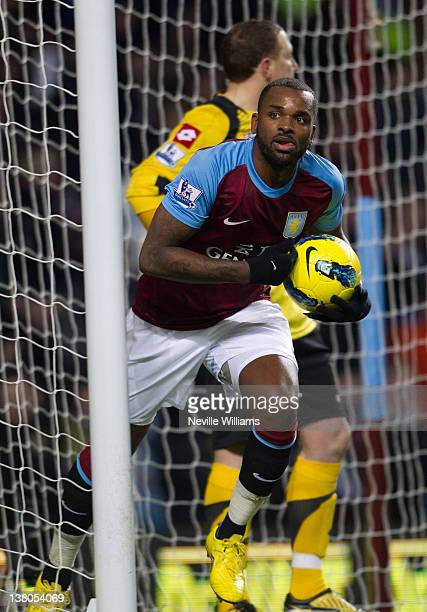 Darren Bent of Aston Villa celebrates scoring his 100th Premier League goal during the Barclays Premier League match between Aston Villa and Queens...