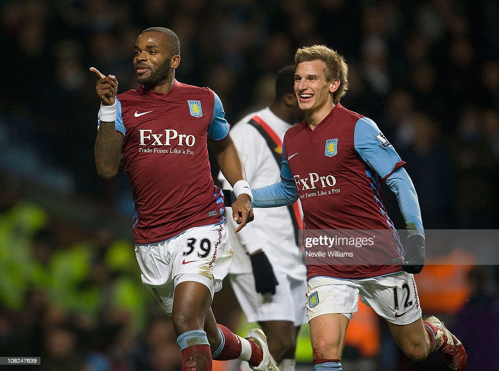 <a gi-track='captionPersonalityLinkClicked' href=/galleries/search?phrase=Darren+Bent&family=editorial&specificpeople=215162 ng-click='$event.stopPropagation()'>Darren Bent</a> of Aston Villa celebrates scoring his debut goal during the Barclays Premier League match between Aston Villa and Manchester City at Villa Park on January 22, 2011 in Birmingham, England.