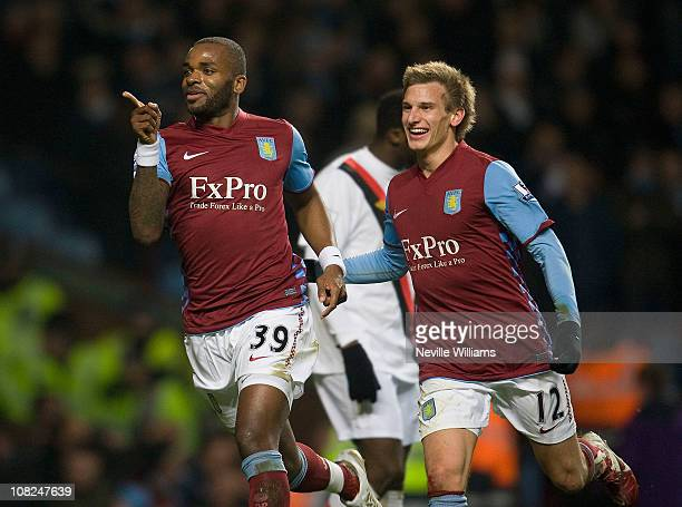 Darren Bent of Aston Villa celebrates scoring his debut goal during the Barclays Premier League match between Aston Villa and Manchester City at...